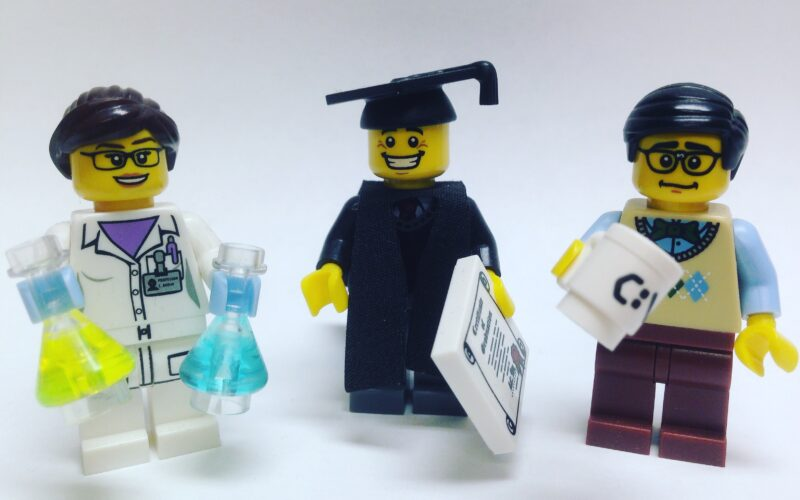 lego figures of scientist, graduate, and office worker