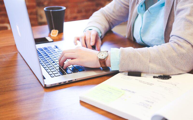 closeup of woman's hands using a laptop