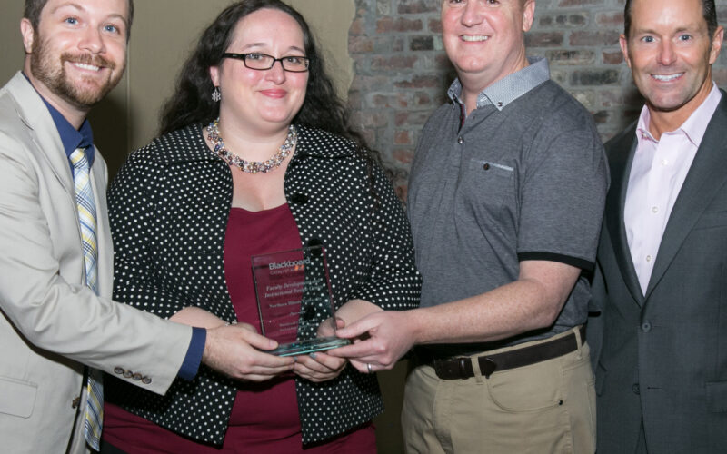 Center staff accept Blackboard Catalyst Award from Blackboard executives